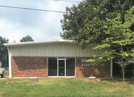 Formally Robertson Electric Company, building consists of 779 square feet of office space with 2 private bathrooms and 3321 square feet of warehouse space. Great location on corner lot. Building is in great condition.