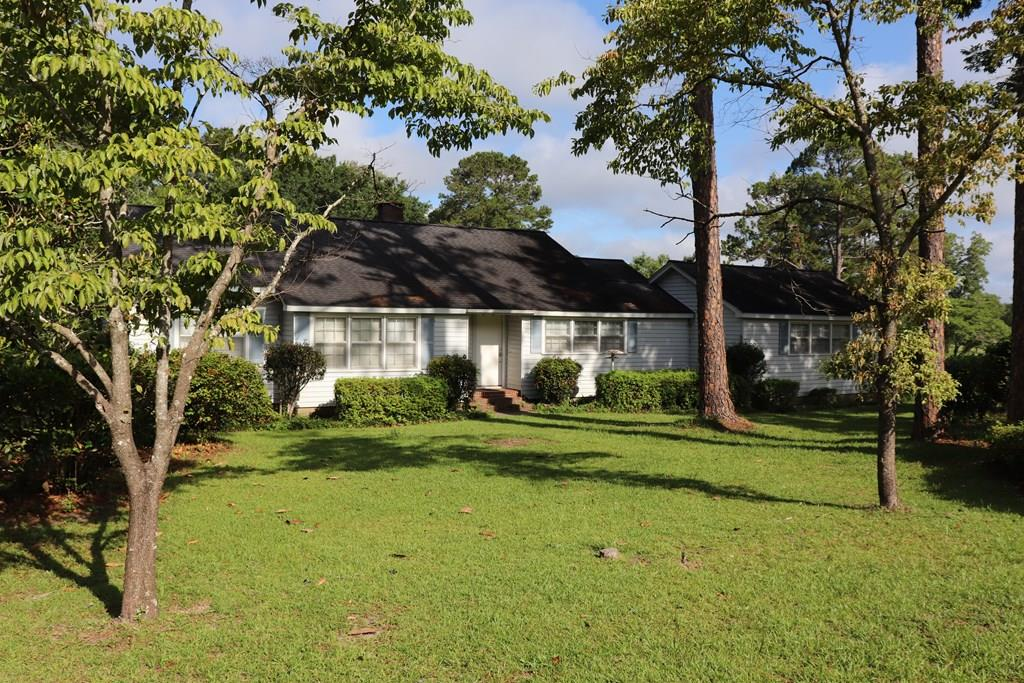 44+/- Acres conveniently located on the edge of the city limits.  A very good looking tract from the home that sits on the corner to the expanse of pasture to the pond that sits directly in the center of the property.  Property is zoned R-1 which offer a good many possibilities.  The property is designated as being Crossroads Neighborhood Commercial as part of the county's comprehensive land use plan.  Many different land uses around this property.  This would make a great residential development or could work for an institutional buyers.  Home, Barn, Well, Pond, Timber, Road Frontage, City Services. Home is on Well and Septic.  Really need to look at the location of this tract and how convenient it is to everything.  This is a good one. Some uses may require re-zoning...but given the many different land uses in the immediate area......and if uses are buffered correctly....this property could shine.  2200 sq ft home built in 1947 per tax records.  Tremendous opportunity.