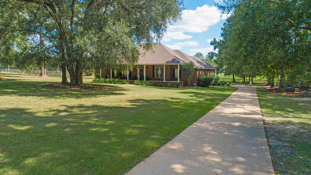 This unique property sits on almost 5 aces and boasts 4 spacious bedrooms and 2.5 baths. The large family room with fireplace and sunroom overlooks the fenced pasture as well as the common area pasture.  The home features 10' ceilings throughout, a living room/office, formal dining room and large kitchen with bar and breakfast area great for family gatherings.  The bonus room is the perfect place to host friends, play ping pong, or cheer on your favorite team.  This horse lovers community has 100 acres of common area and riding trails.  Don't have horses?  Rent your pasture and enjoy watching them!  This is a great opportunity to be part of Gatlin Creek Farms.