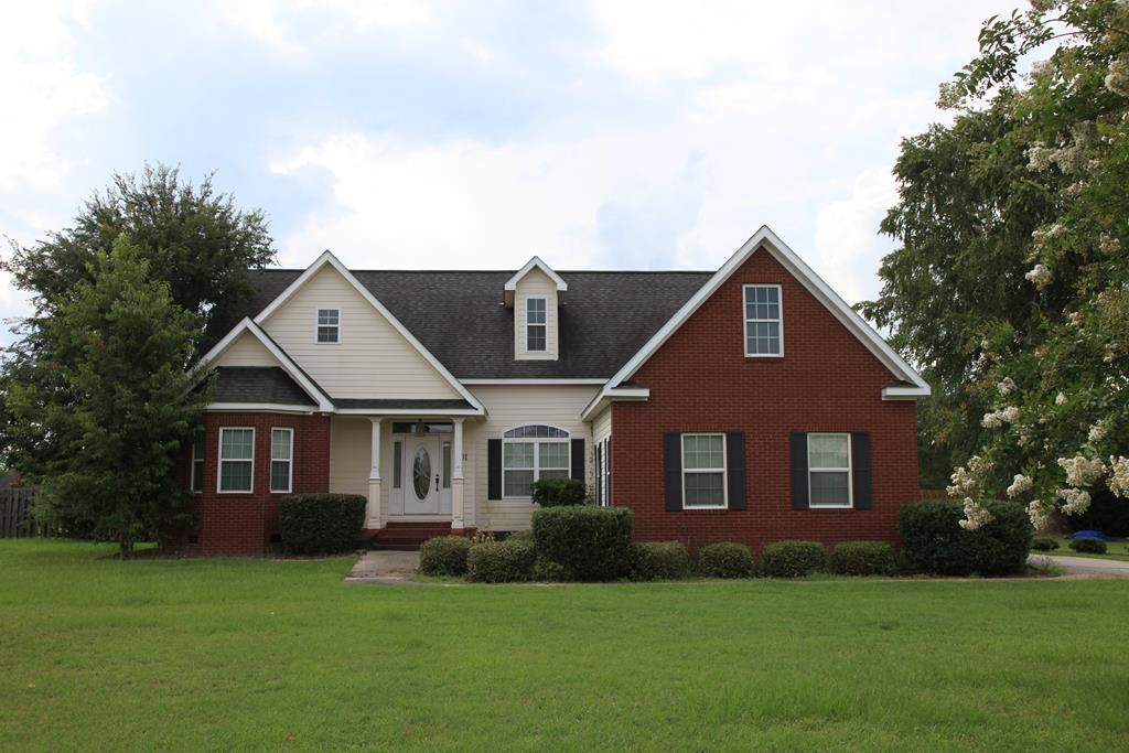 Beautiful 3 bedroom 2 bath brick home! This house sits on a corner lot with .72 acres of land. Built in 2006. Split floor plan that features a formal living room, den with a fireplace and a bonus room! Extra room can be used as a guest bedroom. Master bedroom has a large bathroom with a jacuzzi tub, and a separate tile shower.  Huge kitchen fully equipped with stainless steel appliances, and granite countertops. Immense back yard, with private fence, nice deck and patio, and dog run for your fury friend. Recreational fish pond in the front yard, and sprinkler system. This will make a great family home! Call today to schedule your private tour!