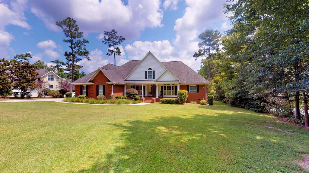 In the county on the Southside of Thomasville...in Polana! This brick home features a fabulous floor plan. Formal dining room, study/home office and formal living room with French doors and windows to backed screened porch overlooking large backyard and pond. Well planned kitchen with custom cabinets with quartz countertops, open to a spacious family room/gathering area that has a fireplace and an inviting breakfast area going out to the porch. Hardwood, carpet and ceramic tile flooring throughout. Great master suite with lovely master bath, double closets, dual vanities, whirlpool tub and water closet. Upstairs is a bedroom and a bath. Double garage, Anderson windows. Lots of square footage for a growing family or the perfect floor plan for couple expecting lots of company!