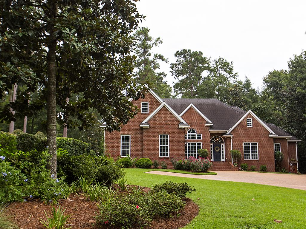 Custom built brick home in the great family neighborhood of Polana on the south side of Thomasville. So many beautiful touches throughout such as hand scraped oak hardwood floors and solid pine doors. Prepare delicious meals in the gourmet kitchen with granite countertops, solid cherry cabinets, and stainless appliances including a 6 burner gas cooktop. The spacious living room with built in entertainment center and surround sound will make movie nights even more fun! An oversized master suite offers a private sitting area with fireplace. Outside there is a screened in porch with water, gas, & electricity hook ups just waiting to become an extraordinary outdoor kitchen. Step off the screened porch to another patio with wood burning fireplace perfect for enjoying crisp fall nights. Mature landscaping all around ensures privacy as you enjoy the outdoors. Other custom touches include a 3 zoned thermostat-controlled HVAC, and climate controlled attic and workshop.