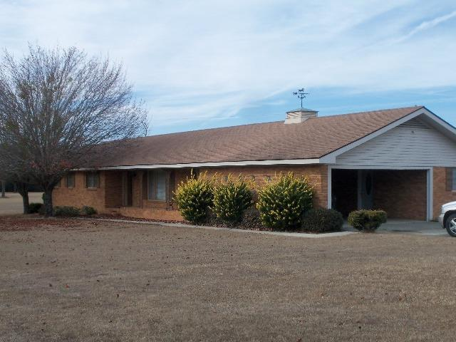 """The lovely, well maintained, country home is located just Northwest of Quitman, GA.  The house boast that """"country"""" feel, but is convenient to schools, churches, medical facilities, shopping, etc. . This home has been owned by the family since it was built in 1967.  This is a quality built brick home with all the amenities necessary for comfortable living !  The adjoining 76.76 acres (MLS # A914687A )may also be purchased for $380,000. This property is mostly pasture land with a approx. 2.2 acre pond."""