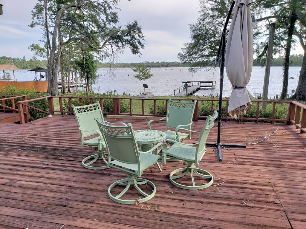 What a great lake house at Lake Seminole! This property has plenty of room to roam on almost 1 acre on the lake! The home features an open floor plan, sun room and large open deck overlooking the lake that is perfect for entertaining. Dock is great for fishing or enjoying the scenery. There is an additional cottage that's perfect for a man cave, guest house or rental. Part of the property has 5 foot chain length fence. All new appliances, HVAC, roof, generator and new front deck. This home is move in ready and comes furnished with washer and dryer. Don't miss this opportunity to own a fabulous home at Lake Seminole. Call today for your showing!