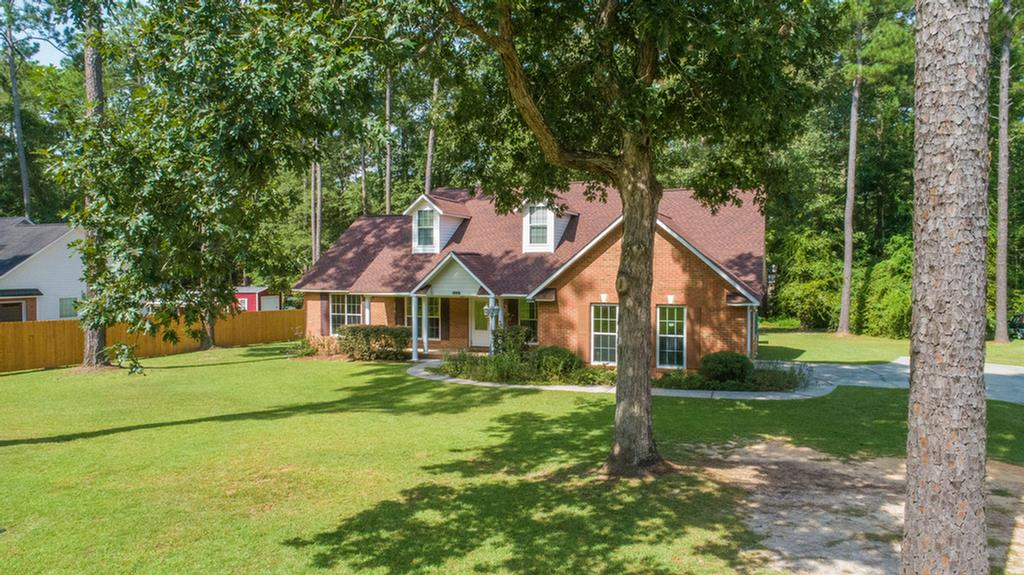 Beautiful brick and hardy board home at Northwoods.This home has 2000 sq.ft. heated & cooled. Offering 4 Bedrooms, 2 Baths. Nice kitchen is open to great room with lots of cabinets, breakfast area with Bay window,  appliances include dishwasher, range with double ovens, built-in microwave and refrigerator. Formal Dining Room with High Ceilings and Beautiful Wood Flooring, Large Master Bedroom with trey ceiling, master bath with Whirlpool tub, Separate shower, Large walk-in closet. Back porch and a Large Patio. 2 car garage. This home has an off-grid Bank solar system. This system is for power outages and back up lighting. This is not a grid-tie system that generates power back into the electrical grid.