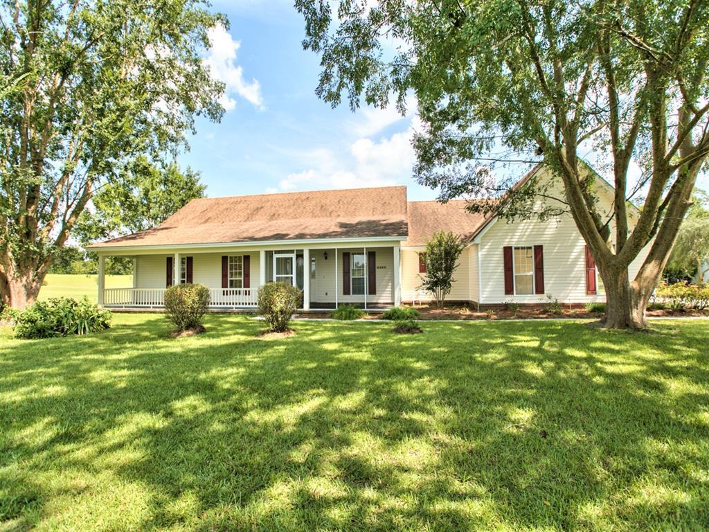 Location approved for 100% USDA financing for qualified buyers.   Beautifully maintained home on 2 Acres just minutes from the heart on downtown Historic Quitman.  Home has over 2200 sf with deeded access to the Quitman Country Club!!!  Features include large eat-in kitchen, sunroom,  open porch (and screened porch),formal dining, family room w/ trey ceiling and fireplace, large bedrooms with spacious guest bath and  nice master suite.  Roof is approx 3 yrs old and HVAC is approx 5 yrs old.