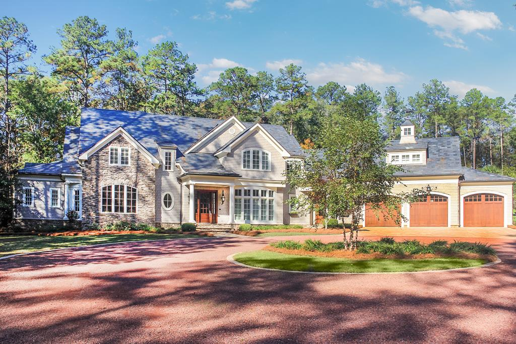 Magnificent estate home on 3.89 acres in the heart of one of Thomasville's most desirable neighborhoods. Perfect location close to Glen Arven Country Club, Archbold Hospital, Thomas University and Jerger Elementary School. Custom designed by Troy Stencel in 2004, southern charm is found in all aspects and details. The main house features 7,873 sf w/ 7 BR, 5 full BA and 2 half BA with floor plan for formal living, formal dining, family room adjacent to unique double island kitchen and study off of main level master. Multiple outdoor living spaces include main living room porch, circular fireplace porch & grilling porch all adjacent to the gunite saltwater pool/hot tub deck. The pool house features 981 sf w/ full kitchen, 1 BR, full BA, large family room w/ 2 car garage.  The pool house is serviced by a separate drive/gate off of Glen Arven Dr allowing anonymity for family or guests if needed. Call today to schedule a private showing. Additional fact sheet and photos upon request.