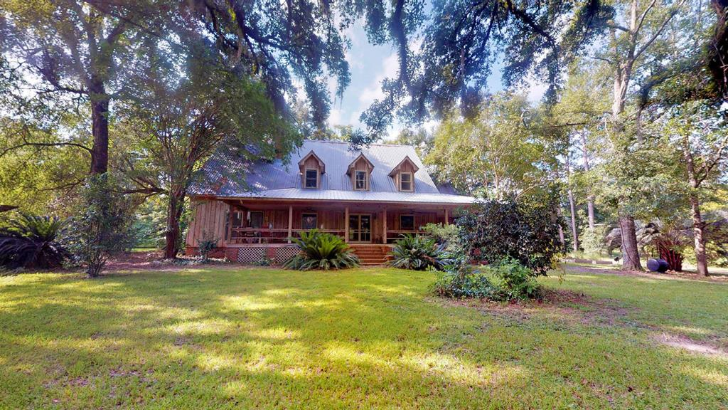 Remarkable opportunity with this 3800+ sq ft, 4/3.5 Plantation home! Nestled in the midst of 30 acres of the finest of Red Hills terrain, this beautiful home offers privacy, space, & the atmosphere to create the anchoring home environment of your dreams!!  From the wrap around porch, to the numerous barns/sheds to the fruiting, flowering & nut trees you won't believe all this property offers. From the upstairs with 3br & 2 bonus rooms & TONS of storage space ---- to the downstairs living areas; from the chef's dream of a kitchen with its miles of counters & tons of cabinets & pantries to the shelf-lined library .....you will have room to grow, to live, to dream, to build. The custom cabinets were created from wood of the original old home *built from the trees harvested on the property* known as the 'Bush' house (la. Harvest your own chestnuts for roasting in the massive fireplace, watch the wild game, enjoy the solitude! There will never be another one JUST like this!! Call today!