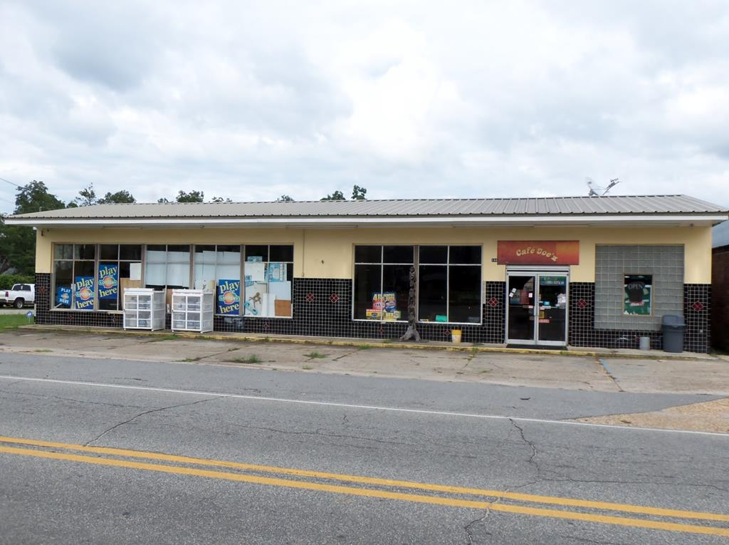 Great opportunity for a new business in downtown Pelham.  The building 7,500 sq. ft. is divided for different uses, the front 3,750 sq. ft. prior use was convenience store with coolers and equipment, two bathrooms and kitchen area that would be great for convenience or retail store.  The other 3,750 sq. ft. in the back is a warehouse that is currently being leased.