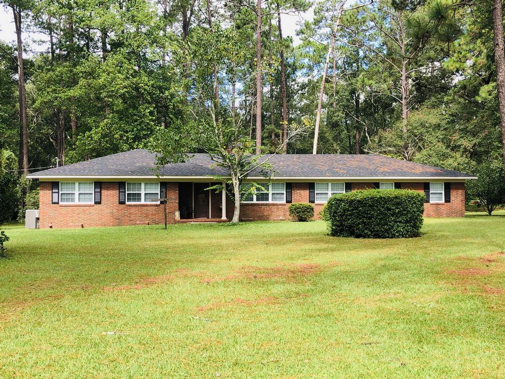 Nice 3 bedroom, 3 bath brick home on 15 acres. This home has an open floor plan, kitchen has hard surface counter tops and pantry, great room with fireplace, master bedroom with master bath and a laundry room are some of this homes features. Flooring has tile and engineered hardwood and out back you will find a sun porch that overlooks the property that includes a pond.   Out in the county but close to everything in town. Come take a look you won't be disappointed.