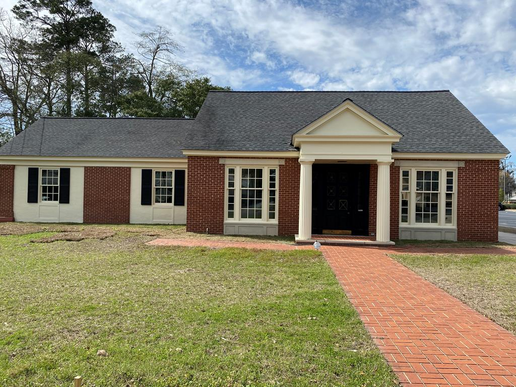 Beautiful, move-in ready, office building.  Set up for medical practice with large lobby, reception area, 2 private offices, 5 exam rooms, 5 restrooms.  Plenty of parking.  Would make great offices for just about any type of business.