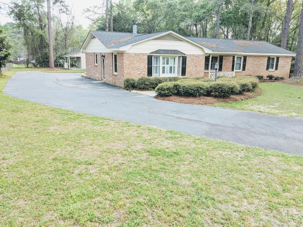 BRICK ranch in the country, just outside city limits.  MOVE-IN READY.   Attached dbl. carport walks into movie/game room.  4th Bdm had no closet.  Bathrooms are updated and nice size.  Fireplace in living room/den.  Modern eat-in kitchen w/bar dining also. Lg. pantry and laundry room. Covered back patio for grilling with fenced-in area and covered front porch. Out bldg. w/lean-to. Nicely landscaped with fountain area.  City amenities and neighbors, but no subdivision.  Raise some chickens and grow some food. A camera system comes with the home.