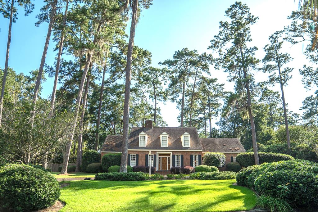 This classically designed home is well located in one of Thomasvilles most desirable areas.  The homes architect was Frank McCall, known for his exacting scale, proportions and detailing. The homes beautiful custom moldings, reclaimed heart pine floors, cabinets, and built-ins were all produced by the famed Bracey Millworks, whose owner also commissioned the homes construction. The home has a formal living room and dining room. A large pine paneled and beamed den, complete with fireplace, is located in the heart of the house. The adjoining kitchen has been beautifully updated to included granite counter tops, tile backsplash and all new stainless appliances. The downstairs master suite features double vanities, granite counter tops, and an oversized custom tile shower. Three additional bedrooms along with three full baths are located upstairs. A veranda off of the kitchen leads to an attractively landscaped and private back yard. This home is a great value and a must see!