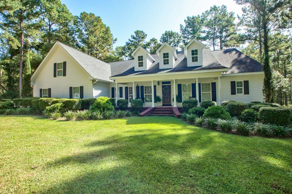 Surrounded by large plantations, on this 21+ acres, you can hunt, play, ride or relax! Every detail was meticulously thought through.Perfect blend of modern conveniences w/warmth & charm. 4 BR, 3 full BA& 2 half baths, full bonus rm, this home has beautiful hardwood floors throughout, a spacious kitchen w/ custom cabinets, separate prep sink in the island, walk-in pantry, custom cabinets & Kenmore Pro Series appliances. Its a chefs delight!  Family rm has more than enough room for everyone to gather & enjoy a football game or fire in fireplace. Master suite has a luxurious bathroom, jetted tub,double vanities & plenty of room in the enormous walk-in shower. You can access the master closet from laundry rm to make putting laundry away easy!  Each bedroom has large walk in closets & plenty of extra closets all through the house. Outside you will find a fabulous screened porch & patio that can be used year-round! A full 2 car garage & separate storage area make this property a must see