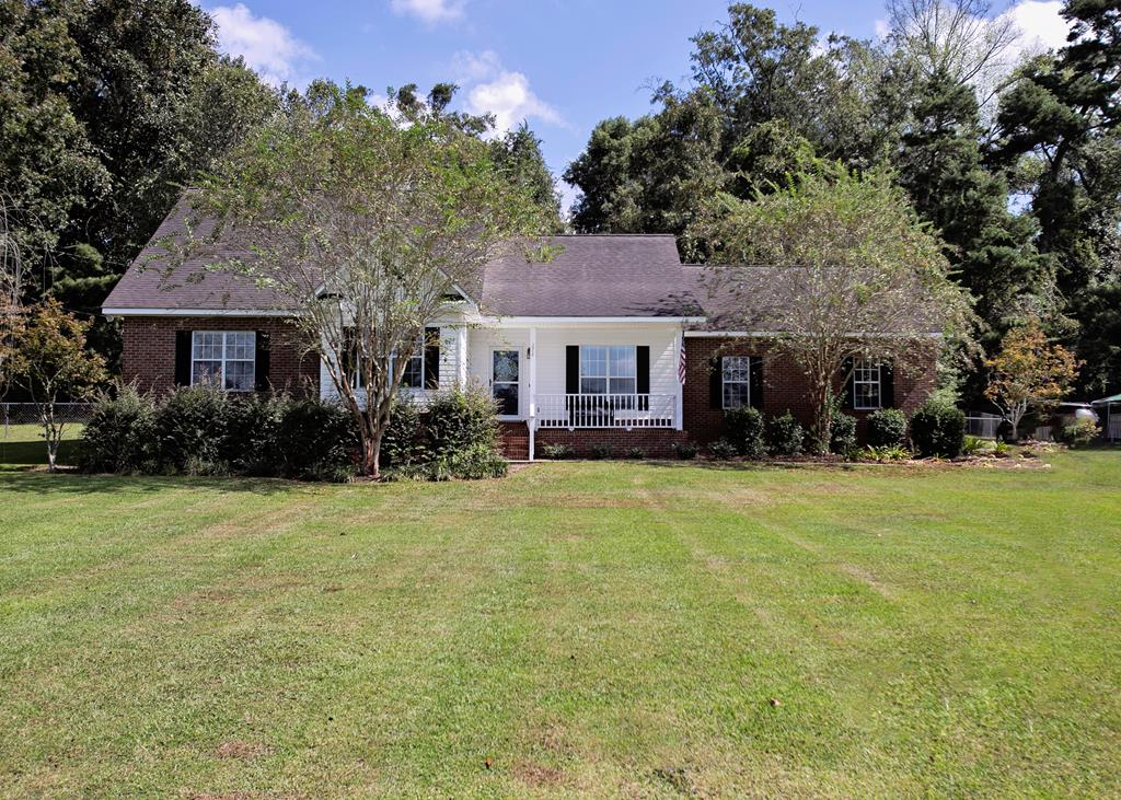 If you want countryside living close to town this is it.  this 4 br 3 ba home on a quiet cul de sac is perfect.  close to town for easy access to schools, shopping and entertainment, but at the same time has a secluded feel.  The double lot give the family plenty of space to play, add on, or just enjoy.  The patio on back is a great place to wind down at the end of the day.   The open floor plan and two master suites give room for the family and personal space.  This one won't be here for long!!!