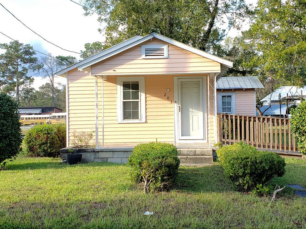 Cozy cottage has just enough space for someone looking to downsize or investor looking for a long term investment. Home has central heating/cooling system, updated windows, metal roof, and aluminum siding. Home sits on a corner lot and has plenty of parking.