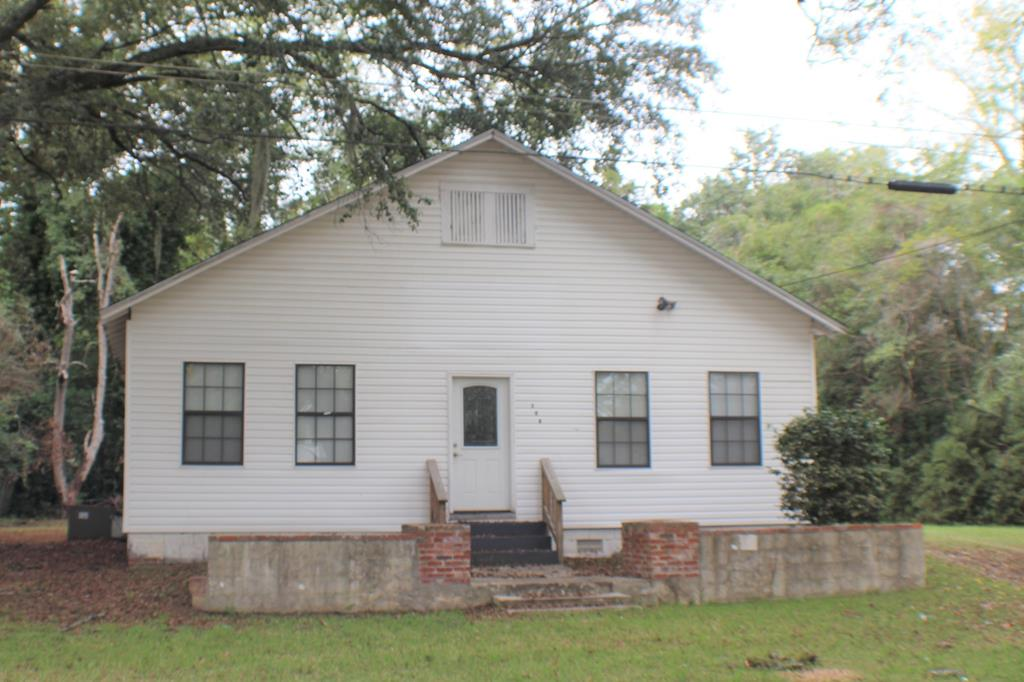Versatile and convenient. This property is located in the heart of Quitman, GA.  It was last used as a church but has so many possibilities.  Possibilities are:  retail, flower shop, day care, professional offices, beauty salon and more.  The structure offers 3 separate rooms, bathroom, full kitchen, dining area and huge multi-purpose room. This was once a residence and could be easily converted back to one. Come explore all the possibilities.