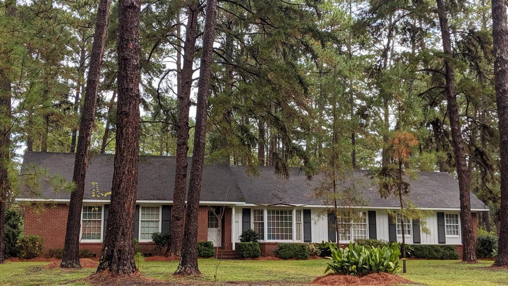 """HALF MILE TO GLEN ARVEN COUNTRY CLUB.  Near Jerger School, this 3/2 brick home has an attached double carport and fenced backyard.  Plenty of room to add on and a yard for playing. 2"""" Oak floors are in good shape.  Nice size bath in master.  Enjoy sitting on the patio off den and pick fruit from many types of trees.  Take the golf cart downtown for breakfast!"""