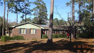 Calling all investors! Take a look at this large brick family home on 6 acres conveniently located on the north side of Thomas County. With almost 3000 sq ft, there's room for everyone! Would make a great fixer upper for yourself or as an investment. Needs a lot of work, but has tons of potential and is priced with that in mind. There is also a power pole and an additional septic tank on the property where a mobile home was located at one time.