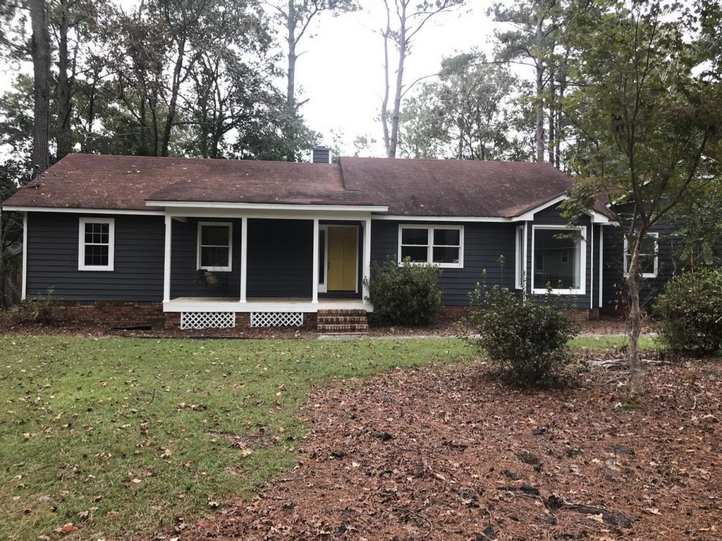 Very desirable neighborhood in town. This 3 bedroom 2  bath is recently remodeled and is SUPER nice. Has a laundry room with a sink and half bath as you walk into house from carport. New windows and doors and decks. 2 water heaters which  1 is a year old and the other is 2 years old. New air conditioner and roof has a good 10-15 years left. Living room has a fireplace with long windows that make it feel very open. This house has a lot of windows making you feel like your outside. Wow you just have to see it to appreciate it. Dont let this pass you by!!