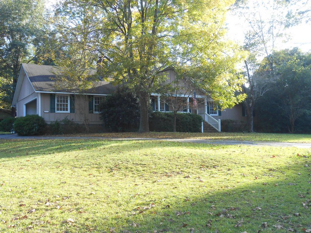 This home is located close to Brookwood School on a large lot at the end of a cul-de-sac. Home has 4 bedrooms, 3 and a half baths. The 4th bedroom could be used as a playroom or additional family room. This home has tons of oversized closets for storage. The sunken living room has a brick fireplace with gas logs and built in shelving. Located off of the family room is the kitchen that has a breakfast nook. This home has a formal dining room that is currently being used as an office space. All of the bedrooms have ample closet space and baths close by. The master bathroom features a jetted tub, walk in tiled shower, double sinks and additional vanity area. Located off of the kitchen is a covered back porch that would be great for entertaining. The side yard has a storage building. The back portion of the yard has a privacy fence. Please call today for your personal showing.