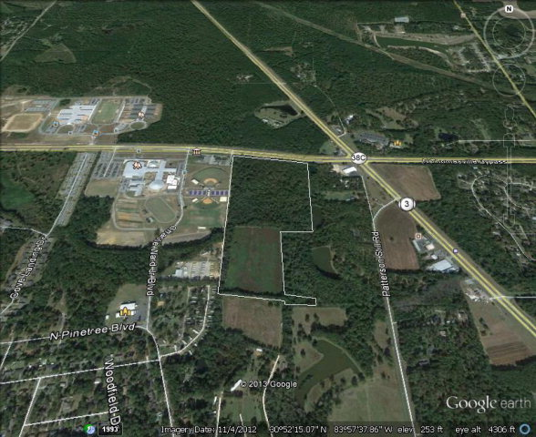 48.75 acres adjacent to State patrol office. DOT has approved access from the by-pass for this property.