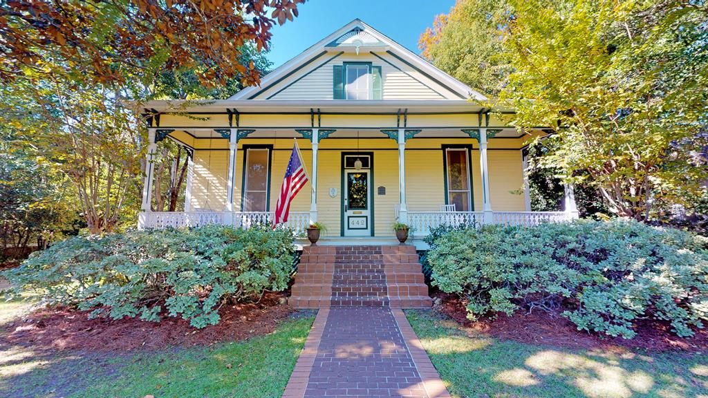 The Cobb House Circa 1890 is located in the Tockwotten District in Downtown Thomasville, GA and has been carefully restored in keeping with the historical Victorian charm.The large front porch leads way to beautiful grand foyer. 14 ft ceilings, leaded transoms,heart pine flooring,and stained glass are throughout this charming home.Floor to ceiling windows have original glass and plantation shutters. Home has 4 to 6 BR/4 BA; so you can decide how to use YOUR space.Four ft wide beautiful wood staircase takes you to the 2nd floor with high vaulted ceilings and oak flooring.Tall ceilings and a basement ensures a COOL HOME IN SUMMER and the gas heating warms it quickly and efficiently. The peaceful exterior includes gardens in the back with a gazebo, completely fenced with a covered carport and a small carriage house perfect for a mother-in-law suite or rental. Home has updated wiring and plumbing.Roof replaced in 2015. Just a short walk to vibrant downtown, local schools,and 3 local parks.