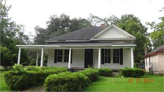 Take a step back in time. You can walk to down town shopping & restaurants & the Amiptheater.Close access to the new City walking trail & Paradise Park.See Thomasville's Fouth of July Fireworks from the wrap around front porch! This unique home is ready for your personal touches & tender loving care.Partially renovated & in move in condition. New interior paint w/ a dramatic designer flair, refurbished original hard wood floors, new linoleum tile, new stainless steel refrigerator,stove, & farm sink w/ new kitchen cabinets & counter tops.Remodeled bathroom & 2 spacious BR. Living rm, dining rm, butler's pantry, laundry rm/ mud porch combo w/ large bonus rm for storage. Brand new full size, side by side washer & dryer.Recent improvements include repaired subflooring, new up to code electric & plumbing, attic insulation, attic pest sensors & chimney repairs.New roof added in 2012 & new central heat & air unit added in 2015. This home is in the Victoria Place revitalization district.