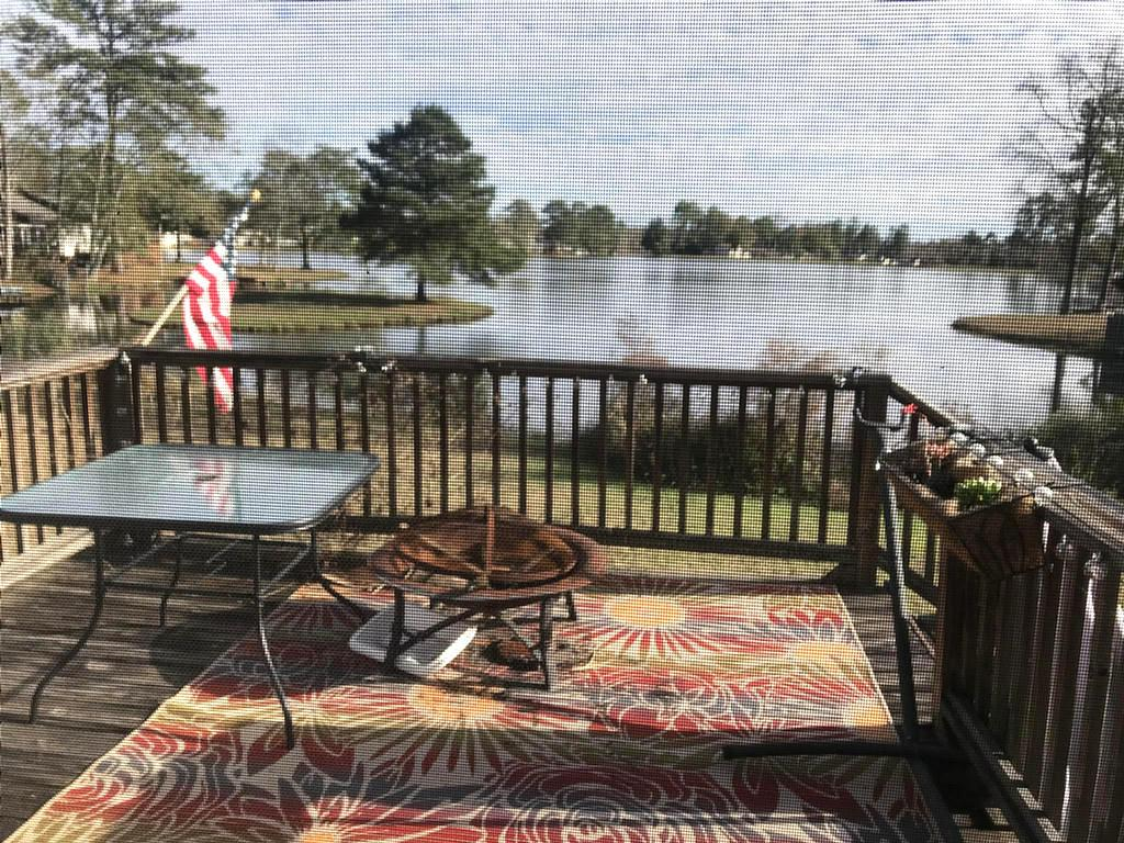 On The Lake! 4 Bedroom 2 bath and 1/2 bath, Large Livingroom and diningroom, nice kitchen looking out on deck  and sceenporch with a serenity view of the lake.  This Townhouse is close to shopping ,restaurants and post office.  Occupied until May!