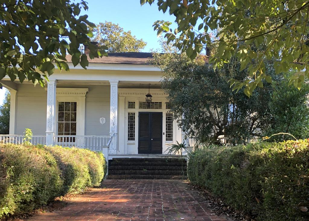 Formerly known as the Wright House, this property is abundant in potential for either commercial or residential use.  Within walking distance to downtown Thomasville's dining & shopping, Paradise Park and The Ritz Amphitheater, this is a great opportunity to become a part of Thomasville's Historic Fletcherville District.  The beautiful, historic home was formerly used as a bed and breakfast and features include four bedrooms, three and a half baths, a central hall with arched doorway, hardwood floors, screened porch and much more.