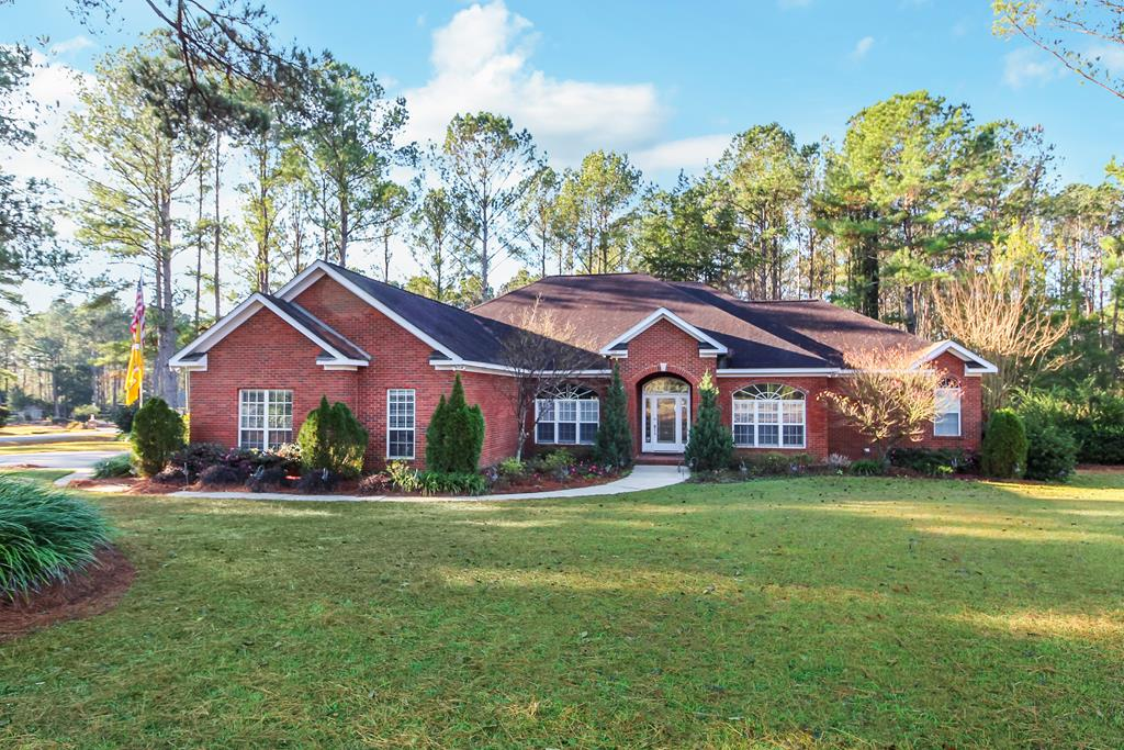 This beautiful property is located on 1.01 acres in A Place In The Woods subdivision.  It features 4 bedrooms, 3 full bathrooms and 1 half bath. When you enter the home, you'll notice the open floor plan and nice high ceilings.  The property features a split floor plan and offers large bedrooms and closets. From your master, you can walk out onto your spacious sun room that would be an excellent place for your morning coffee or to watch the kids playing in the fenced in backyard. The kitchen features updated quartz countertops and is open to your large family room that has a nice fireplace.  With all of the features this property offers, it's definitely a must see.  Call today to schedule your private tour!