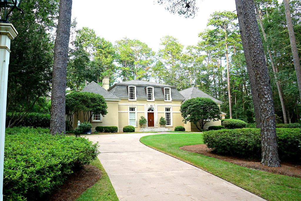 """Beautiful French provincial home designed by Frank McCall. Built in 1982 this 4 bedroom home sits among the longleaf pines on a quiet 1.5 acre lot located in one of the most desirable areas. Close to Archbold hospital, Glen Arven Country Club, schools and downtown Thomasville. Built with exquisite taste and great attention to details the bright and airy home features custom Bracey Lumber millwork and reclaimed pine floors. Downstairs the master suite, formal living, kitchen and family room w fireplace (all w french doors) form a horseshoe opening to the patio and pool. also downstairs are a guest room, powder room, cozy library and formal dining room. Upstairs the landing makes a small sitting area for the two charming bedrooms. Carport with attached """"man cave""""/ golf room could be converted to pool house. The landscaped double lot offers the feeling of privacy for such a conveniently located home."""