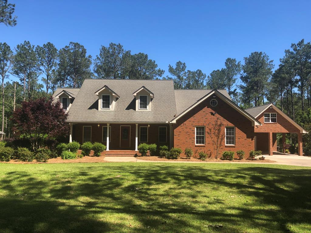 """This custom-built dream home in the country has five (5) acres, 24' x 36' barn, gorgeous pool and a 2-story studio that can easily be converted to a guest suite. This property has 5 bedrooms/3 bathrooms and tons of storage space throughout. The kitchen has an eat-in breakfast room with a unique tin ceiling. Very attractive yards with plenty of room for entertaining and also has access to a shared pond. Additional acreage may be available! Enjoy the privacy of this home with only a few miles to restaurants, shopping and schools. This home features a large den with fireplace, master suite with a claw-foot soaking tub, and many more exquisite features. This is a """"must see"""" as features are too numerous to continue to list. Call today for more information and a private tour."""