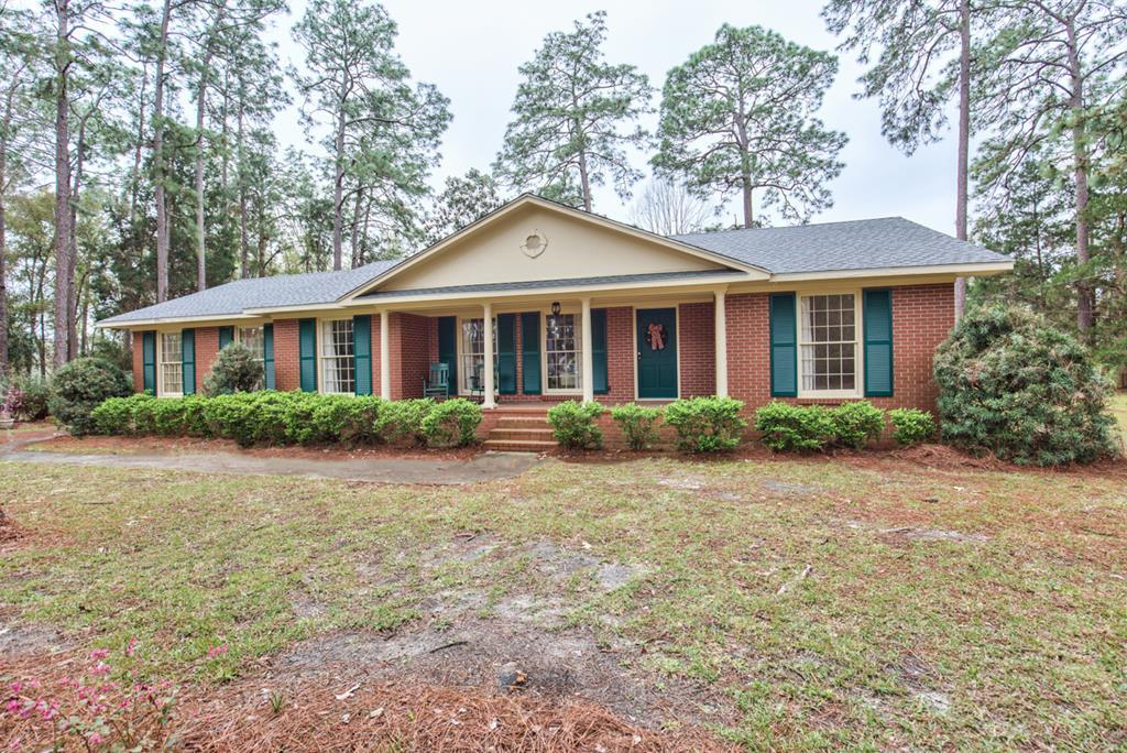 This lovely Brick home is situated on  3.8 acres with  lots of  shade and room for children and animals!  Located just inside the Quitman City limits the property is bounded by plantation property on two sides, giving it that quiet, country feel! . Only a few minutes drive to Churches, Restaurants, Medical facilities, grocery stores and other retail activities. This home has just recently had extensive updating including paint, wallpaper, new flooring, new cabinetry  and appliances in the kitchen, new a/c unit, as well as a new roof in the last few years!  Huge fenced back yard gives a great area for pets, animals and children!!! A new portable building was recently placed on the property and will remain as part of this offering. If you are looking for a MOVE IN READY home with lots of charm, don't miss this one!  SPECIAL NOTE: Light fixture in Dining Room will be removed prior to closing.