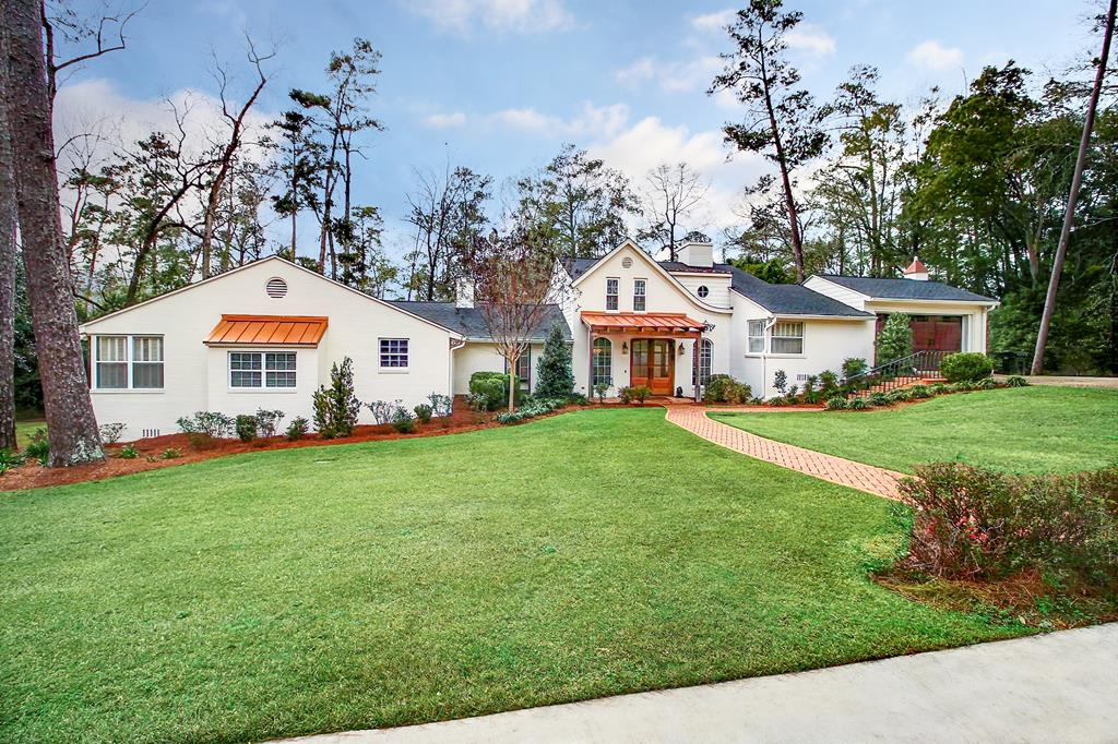 With almost 4700 sf on 1.26 acres, the original structure was built in 1935, but was remodeled  in 2014.  4 beds/3 full baths along with 2 half baths are located on the multiple levels of this home.  Spaces include formal dining & living, a gourmet  kitchen overlooking the vaulted ceiling family room. The laundry, located at the side entrance, is perfect for dropping bags, coats and athletic gear.Charming details include beautiful exposed brick walls, magnolia wood wainscoting, standing seamed metal roof accents and original wood floors.  The expanded master suite, located on the main level, is spacious enough for an office or sitting area. The enormous tiled bathroom is reminiscent of your favorite spa, and is coupled with a large  custom closet.  3 additional bedrooms are located on upper levels with 2  added bathrooms. Multiple French doors open to the deck and patio areas. Single car garage and large separate storage building complete this property.  Call today for an appointment.