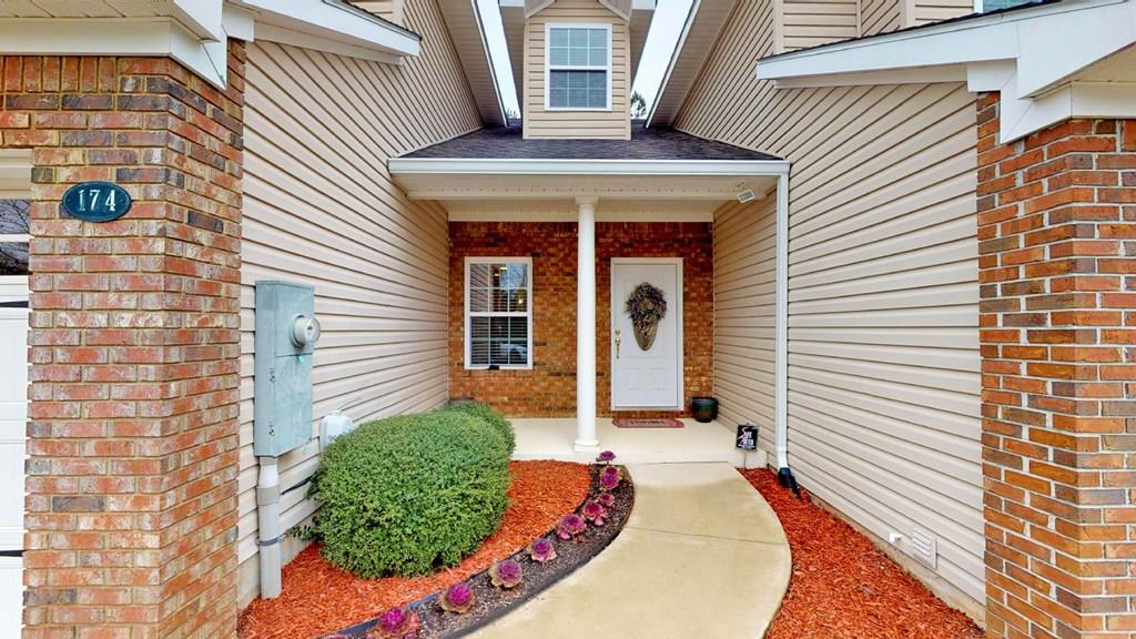 This attractive 3 bedroom, 2.5 bath town home is just blocks away from historic downtown Thomasville, schools, shops and restaurants. It is located in a lovely gated community that also offers a clubhouse, a beautiful pool and indoor fitness center. Walking trails are also on the property for outdoor exercise or relaxing. The first floor has a spacious living area, 1 car garage, covered front porch, screened in back porch, kitchen, laundry room, 1/2 bath, and master suite. The kitchen offers plenty of cabinet and counter space, stainless steel appliances and bar seating. The master bedroom is spacious with a walk-in closet. The master bath has a double sink vanity, soaking tub and separate shower. Upstairs has two bedrooms with a shared full bath and 2 additional storage closets.  All lawn maintenance is covered. Come embrace the low maintenance lifestyle.
