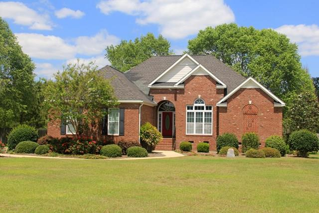 This custom brick home is located in the popular Heards Pond Subdivision.  The property features 3 bedrooms and 2 full bathrooms.  When you enter the property take notice of how open the floor plan is and how great the high ceilings compliment the rooms.  With a kitchen that is open to your living room and looking through the breakfast area, you can look into your huge backyard.  The property has a split floor plan. Entering into the very large master bedroom, you'll notice room for a sitting area as well.  The master bathroom features his and her vanities with hard surface countertops.  If you have ever wanted a large master closet?? Well you have finally found it.  Enjoy all the extras this property has to offer, including a great neighborhood that is convenient to town.  Call today to set your next appointment to see this fantastic deal!!