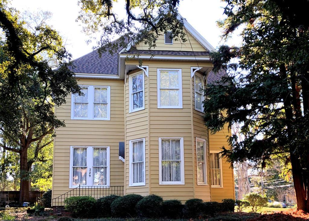 Built in 1897, this four bedroom home is located in the Dawson Street historic district, walking distance to shopping and dining in beautiful downtown Thomasville. This charming home features updated kitchen and baths, oak floors and two master suites - one upstairs and one downstairs. Outside, enjoy evenings in the courtyard complete with firepit and koi pond with fountain. With 2900+ square feet, theres a lot to love in this downtown gem.