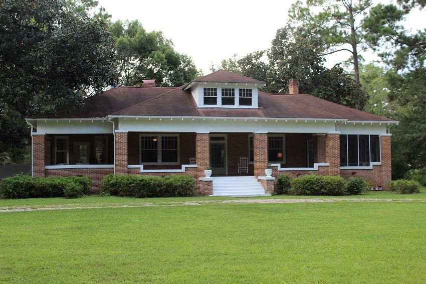 """This house is a true example of southern charm.  The primary home was built in 1923 and is known locally as """"The Rouse House"""".  The stately home is located on a beautiful, large shaded lot, with aged magnolia trees, pines and other southern scrubs. The property also features a pool, BBQ pit and brick patio for relaxing and entertaining.  Also located behind the main house is a guest house of approximately 1048 sq. ft. with private entrance. Perfect for house guest. The main home offers amenities consistent with the period...large central hallway, formal living room with fireplace surrounded by built-in glass fronted bookcases, formal dining room with bay windows,, roomy updated kitchen, 3 bedrooms, 2 baths, family room which adjoins an office or sun room, and back porch /laundry area with restroom. There is backyard and pool access from this area. Hardwood floors, 12 ft ceilings with chair rails and other period architectural details appear throughout the home. MUST SEE!"""