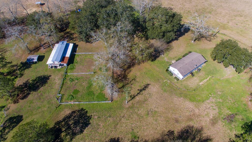 BRING YOUR HORSES OR OTHER LIVESTOCK!!! 36 +/- Acre Horse Farm Located in Pavo,Ga (Brooks Co)  3 BR/3 BA mobile home, 6 stall barn, a stocked pond, and 16 acres fenced.Lots of road frontage, gated entrance, nice homesite, 18 x 20 tractor shed, and room for second driveway.  Includes 2 pastures in field fencing, a 6 acre pasture, a 3 acre pasture, and 2 three board paddocks; plus an optional 4 additional pastures. All pastures have water access.  The approx. 36 x 60 (6) stall center aisle barn includes an indoor wash stall, hot and cold water, washer/dryer hookup, a large tack/feed room, tool room, and full hayloft.  Lots of privacy; property is surrounded by farmland.  Features of the home include cozy family room, appliances. fireplace, master suite with his and hers baths, and walk-in closets in all bedrooms. Lots of deer and turkey on the back of the property.  Beautiful live oaks,muscadines, pecan trees. 15 miles from T'ville,Moultrie, Boston, or Quitman. 24 hour notice to show.