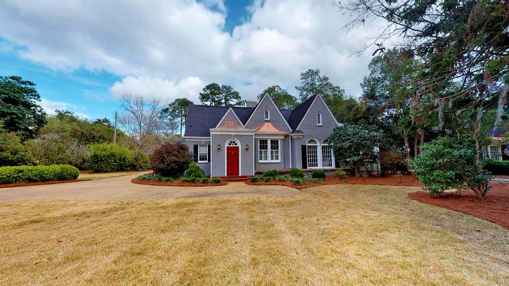 This Tudor style home has 4,184 square feet and includes 4 bedrooms and 4.5 baths. This beautiful home is on 1.91 acres and is secluded by beautiful mature landscaping. There is a formal living room, formal dining room, kitchen with breakfast area and fireside family room with built in bookcases. 3 bedrooms are located on the main level with 1 bedroom, bath and media room on the second level. Main level master suite with sitting area, arched doorways, crown moldings and a home office are just some of the features of this home. A pool/guest house contains a living space perfect for game, media or exercise room as well as a full bath. The second level of the guest house has 3 bedrooms, 1 bath, kitchen and living area as well as a single garage. A separate 3 bay garage features a workshop space with abundant storage. Out back you will find a courtyard, patio and concrete/gunite pool, perfect for entertaining.