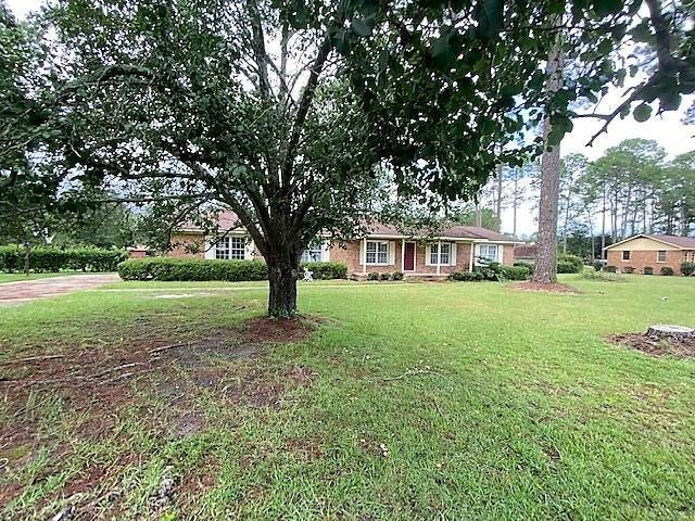 Over 1,800 sq.ft. of living space within this 4bd/2ba brick home in Camilla!  This property sits on over 3/4 of an acre and features a large family room with updated flooring. The spacious kitchen with hard surface countertops and stainless steel appliances, spacious bedrooms and updated vanities in the baths.  A bonus room is a plus and can be used for a home office or sitting area, full laundry room, double carport, and a large back yard.  Sold As-Is!  Call to schedule your personal tour today!
