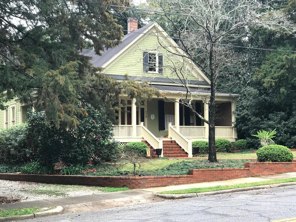 Historic 3 bedroom, 2 bath home close to downtown Thomasville. Eat-in kitchen with gas stove, living room and a grand foyer that could be Formal dining room. Wrap around porch perfect for relaxing and back deck for entertaining. Front yard has professional landscaping. Fabulous 225 sq. ft. shed in back yard