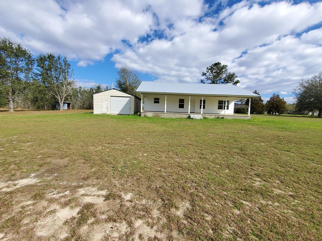 If you're looking for a great starter home or retirement home, this 2 bedroom, 1 Large Bathroom sits on 5.19 acres. It has a detached garage and room to roam. There is a Rocking chair front porch, so you can watch the sunset every afternoon. Call today for your showing.