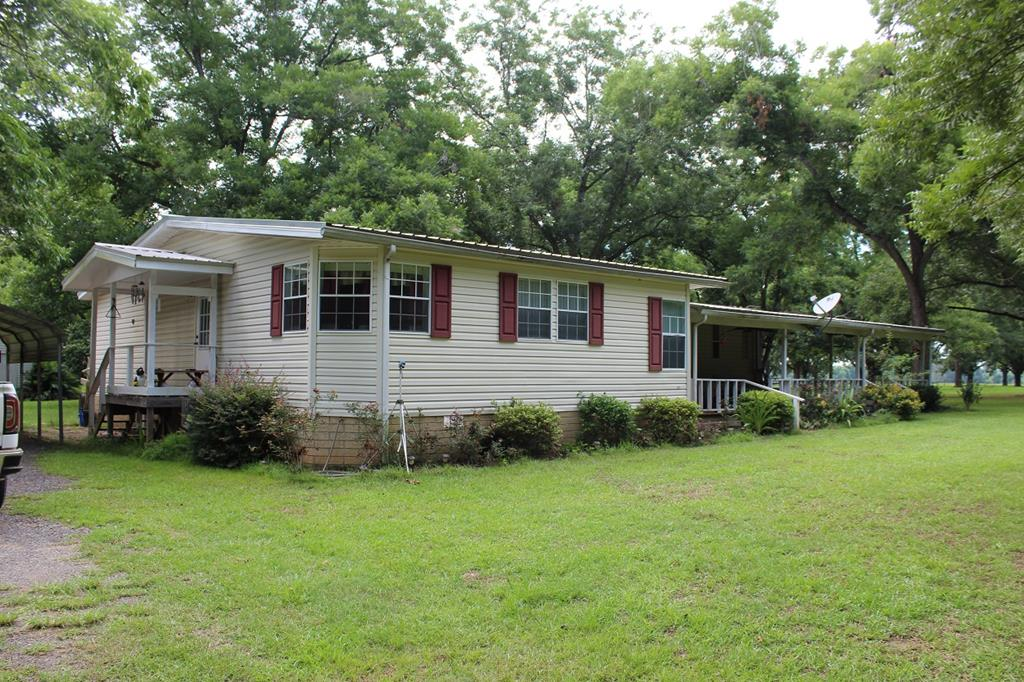 This beautiful property is conveniently located to Valdosta, Quitman, Thomasville, Adel.  The property consist of approx. 150 pecan trees, mostly Desirable, deep well, and 28'x56' Mobile home and small pond.  The home has a split plan with 3BR & 2 full baths.  A beautiful kitchen with breakfast area looks out over the orchard.  Kitchen has an island with PLENTY of custom cabinets.  Dishwasher, Refrigerator/Freezer Stove, Washer and Dryer to remain a be a part of the sale. The oversized family room has a fireplace and room for dining table if desired,  Master Bedroom has walk-in closet, and Master bath has garden tub & separate shower & double vanity. Home is centrally heated and cooled. A/C is only a few years old.  A metal roof covers the entire home and a wide porch wraps the front and north end of the home