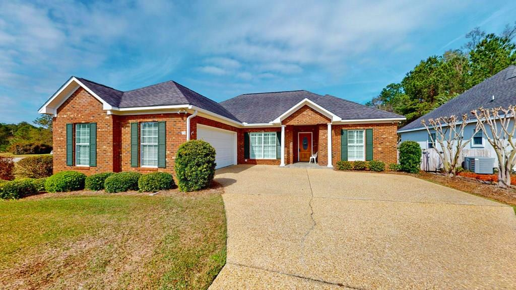 NICE BRICK HOME LIKE NEW in Summercreek Cove.  3 BR/2 BA home with great layout- Formal dining room, great size family room, breakfast area, split floor plan, nice master suite with beautiful tiled walk-in shower, double garage, and private backyard oasis.  Flooring is carpet and ceramic tile.  Great in town location near parks, schools, restaurants, and shopping.  Perfect for low maintenance lifestyle.