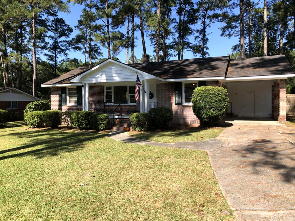 This 1,649 Sq ft 3 bedroom, 2.5 bath lovingly cared for brick home is a must see ! Home is spacious with many extras including hardwood floors, split master plan with walk in closet, abundant storage, carport, patio over looking extra large back lot with room for pool, pool house and garden ! Metal  out building included to keep all of your equipment and storage. Move in condition and in an in town location with city utilities. Home is part of an Estate and is being sold AS IS. Private lockbox on home and out building, please call agent for code. This is a rare find and won't last long!