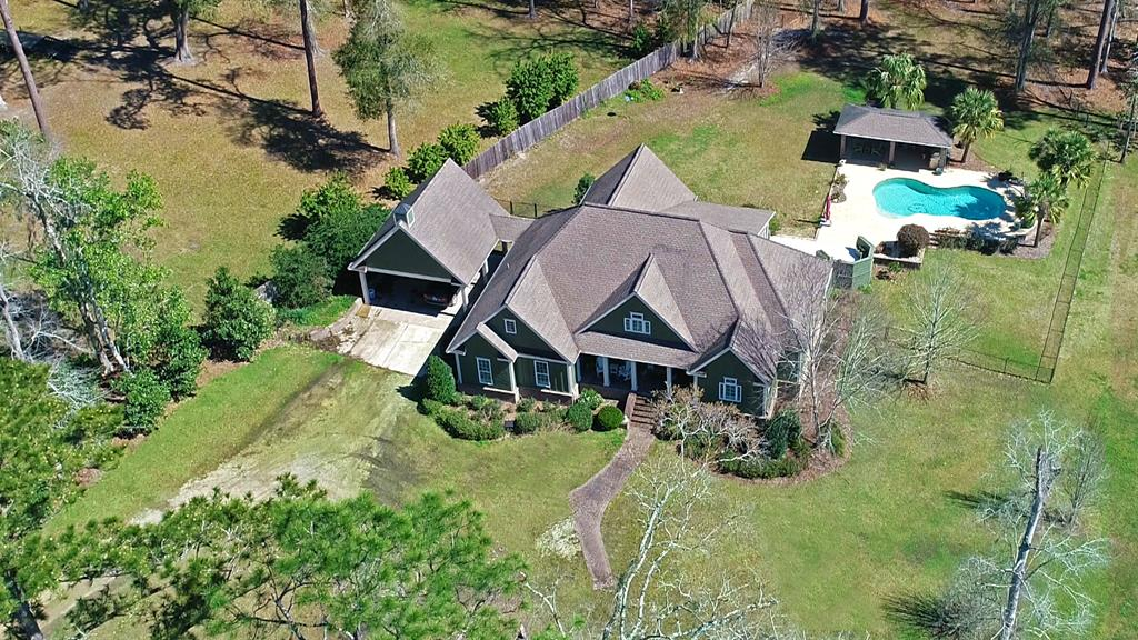 IF YOU ARE LOOKING FOR A FARM, THIS IS IT! This luxurious home on 42 +/- acres has a pond, a backyard oasis, a barn, and a pasture. Plus this house is AMAZING! Highlights include 4 BR/3.5 bath, 4,513 sq ft, a fireplace, heart pine flooring, gorgeous sun room, formal dining room, and upstairs bonus area perfect for an office or weight room.The kitchen offers freshly painted cabinets with plenty of storage, a back splash, new stainless appliances, and quartz counter tops. The master suite features his and her walk in closets, a double sink vanity, and french doors out to the deck and pool! The dream outdoor entertaining area has a salt water pool and is accompanied by a covered outdoor kitchen complete with a sitting area and a fireplace! Bring your horses, cows, or goats;fenced and cross-fenced pasture, a storage shed, 3 hay shelters, and an impressive barn that includes nine stalls. 24x48 workshop and 12x24 little storage/run-in play house across pond for your animals.