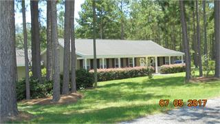 Attached to this 1792 sq.ft. 3/2 home is a pool house /trophy room/rec room with 576 sq. ft. with a sink, all connected by a covered walkway/porch overlooking a vinyl pool.   The pool has chain link fencing and outside of that area is a lean-to, dog pen, dbl. carport, pond, planted pines and a well.   Amazing place for dog trainers and country lovers  right outside Boston, Ga. Attached single carport leads into a combination dining/kitchen/den.  Split floor plan and laundry. Very private.   Wonderful getaway!