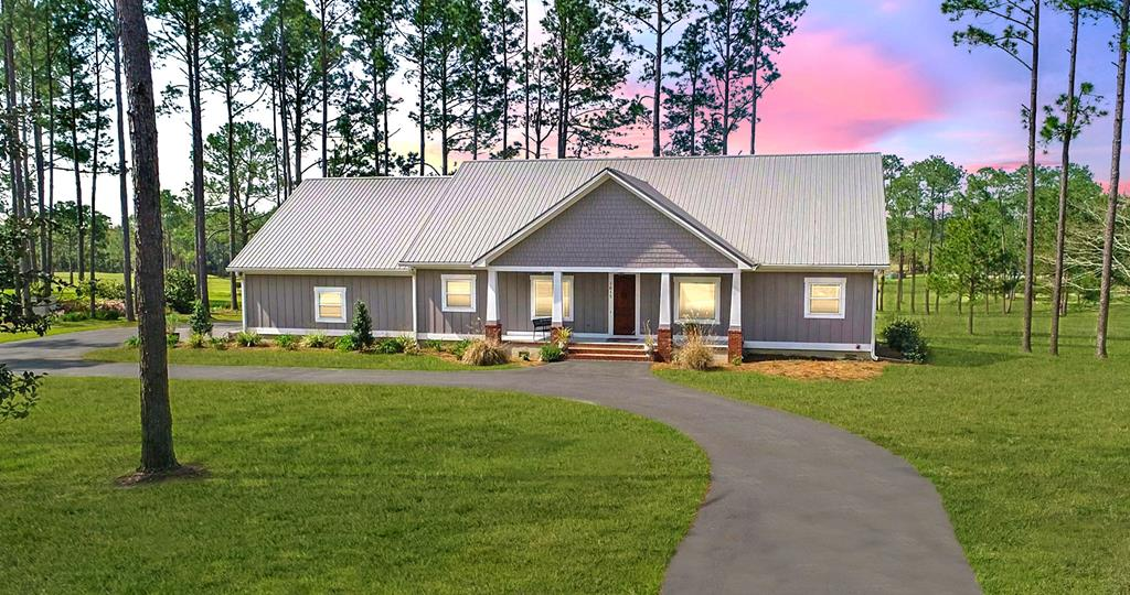 BRAND NEW CUSTOM HOME ON GOLF COURSE IN EXCLUSIVE NEIGHBORHOOD. 3 Bed/2 Bath shaker style home on a secluded street with split floor plan on the 8th hole of the Tired Creek Country Club in Cairo, Georgia. The kitchen features granite counter tops and custom-built cabinetry, a farm sink, and coffee bar area.  The large living room has a built-in entertainment center and a beautiful view of the #8 Green. The secluded master suite is amazing and features a huge walk-in closet, luxury soaking tub, and a laundry room at the end of the hall.  The exterior boasts hardiboard exterior w/ 50 yr. paint, a metal roof, large circle drive, and very large garage with 3 bays. This new home has been completely encapsulated with Styrofoam insulation, and it was designed with energy efficiency in mind. Additional upgrades include formal dining room, nice office, solid wood doors, hardwood floors, a relaxing screened back porch, whole house water softener, LED lighting, and an irrigation system.